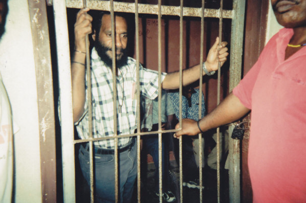 Benny in prison during his trial