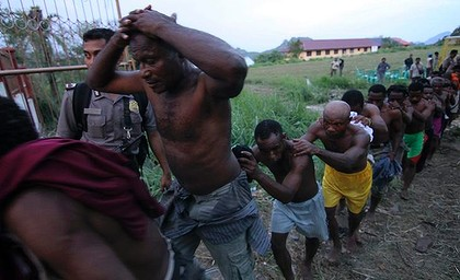 Apartheid in West Papua. Civilians are led away like slaves after being detained following a peaceful meeting in 2011