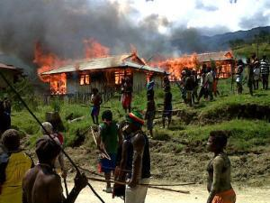 Papuans return to find their homes in burnt to the ground by the Indonesian army following a 'sweeping operation'