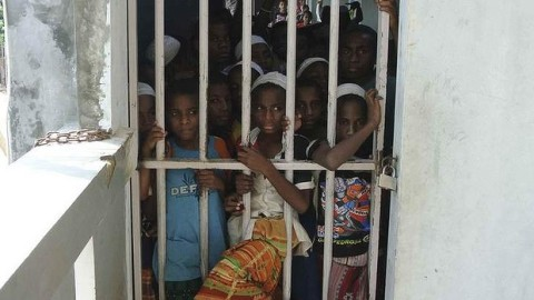Papuan boys at the Daarur Rasul Islamic boarding school, outside Jakarta, behind locked gates