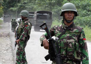 Indonesian military on patrol near the mine