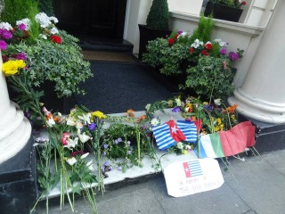 Memorial flowers left by protestors outside the Indonesian Embassy in London