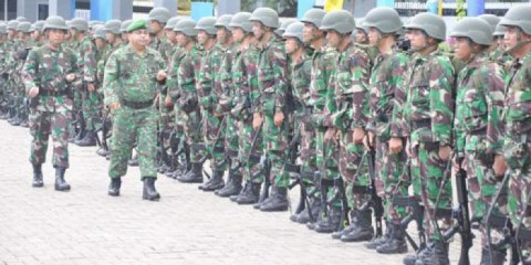 Indonesian Military Commander of the 650 troops with his soldiers