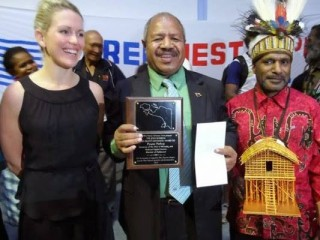 Powes Parkop (centre) receives his award alongside Benny Wenda and Jennifer Robinson