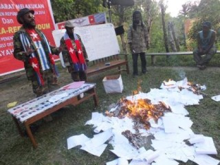 West Papuans peacefully burn their own Indonesian voting papers on 9th July