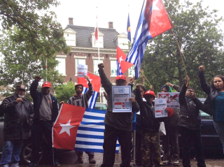Free West Papua Campaign NL protests outside the Indonesian Embassy in Den Haag, Netherlands in support of the boycott