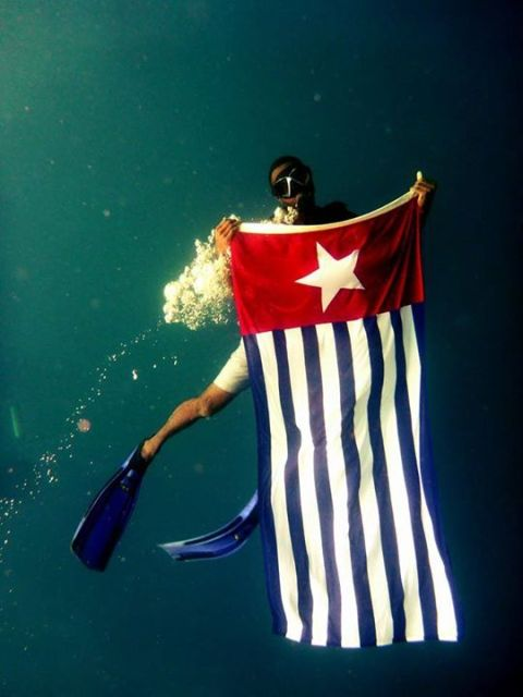 The Morning Star flag proudly held under the seas of Vanuatu.