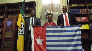 Benny Wenda raising the West Papuan flag with Mr PS Sizani MP, the Chief Whip of the African National Congress (ANC) and Mr Nkosi Mandla Mandela MP, the grandson of Nelson Mandela.