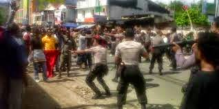 Indonesian police shooting West Papua during the fundraising event