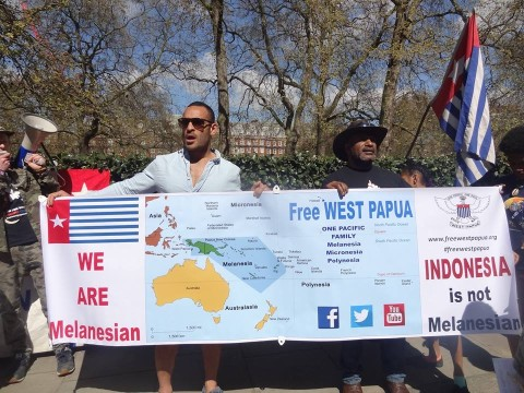 Former PNG Rugby League Captain Paul Aiton holds a banner with West Papuan independence leader Benny Wenda, acknowledging West Papua as part of the Pacific family