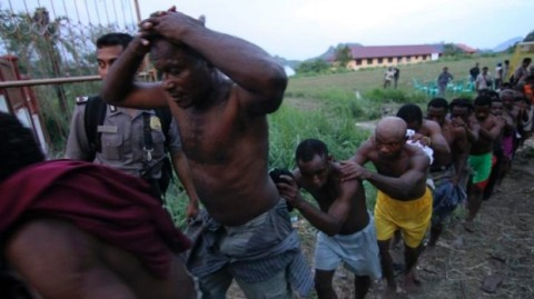 Apartheid in West Papua. West Papuans are stripped, tortured and led away like slaves after a pro-independence congress in 2011
