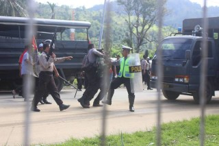 West Papuan man being arrested and beaten by armed Indonesian police in Port Numbay/Jayapura. 28th May 2015