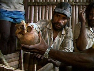 West Papuan man shows an undercover journalist the skull of a fellow Papuan shot by the Indoensian military