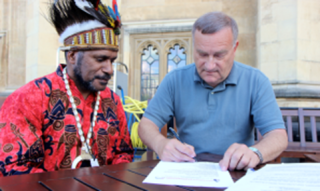 UK MP Nick Brown signing the International Parliamentarians for West Papua declaration in the presence of West Papuan Independence Leader Benny Wenda
