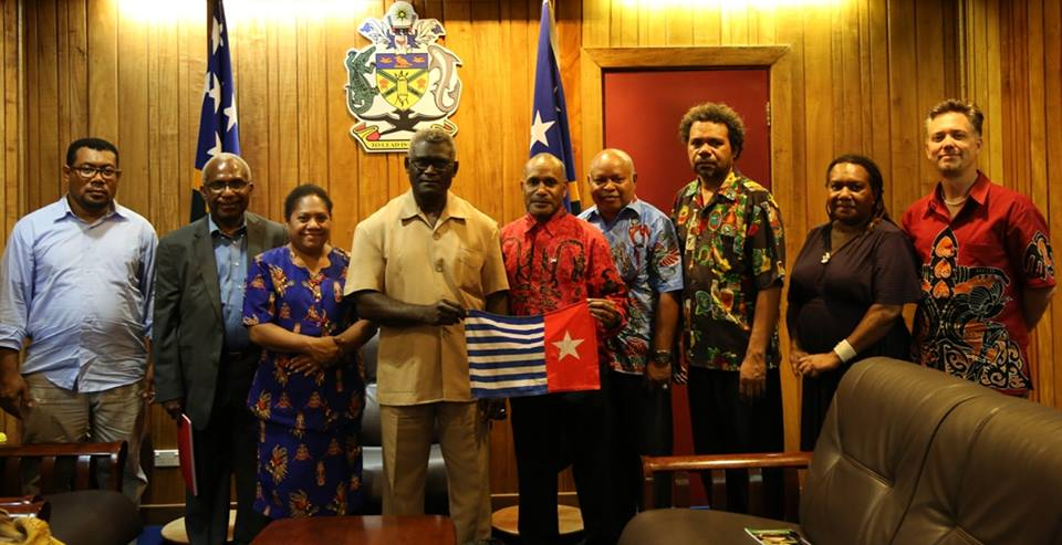 Solomon Islands Prime Minister Hon. Manasseh Sogavare (4th from the left), holding the West Papuan national flag next to West Papuan Independence Leader Benny Wenda and other friends and members of the United Liberation Movement for West Papua (ULMWP).