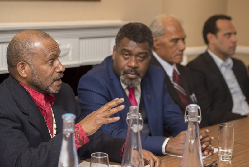 Benny Wenda, flanked by delegates from the Pacific, speaks at a press conference in London on 3rd May. Photo: David Mirzoeff