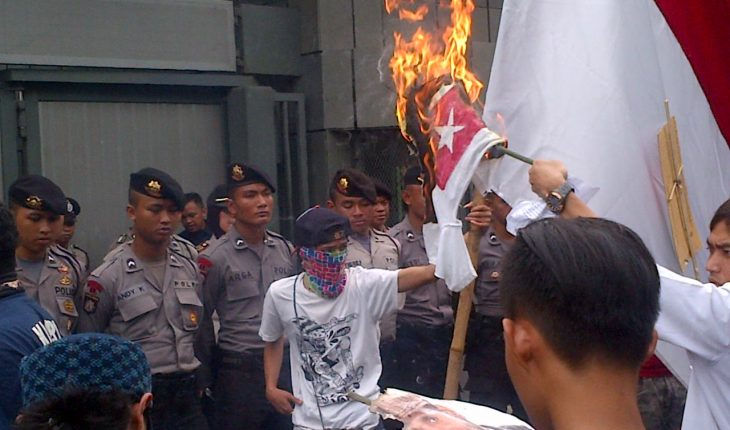 Indonesians burning the West Papuan flag