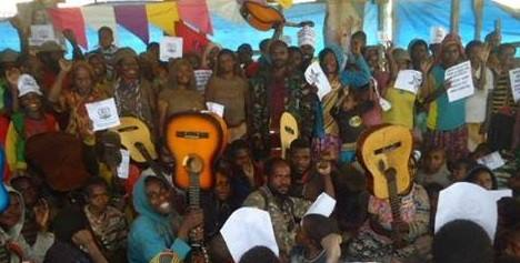 West Papuans in Paniai guitars music is a weapon