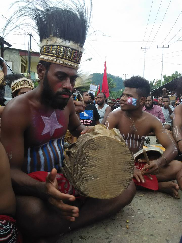 A powerful show of resistance and defiance of Indonesian oppression, a West Papuan student in traditional dress rallies her people in a freedom salute at a peaceful demonstration in December 2015.