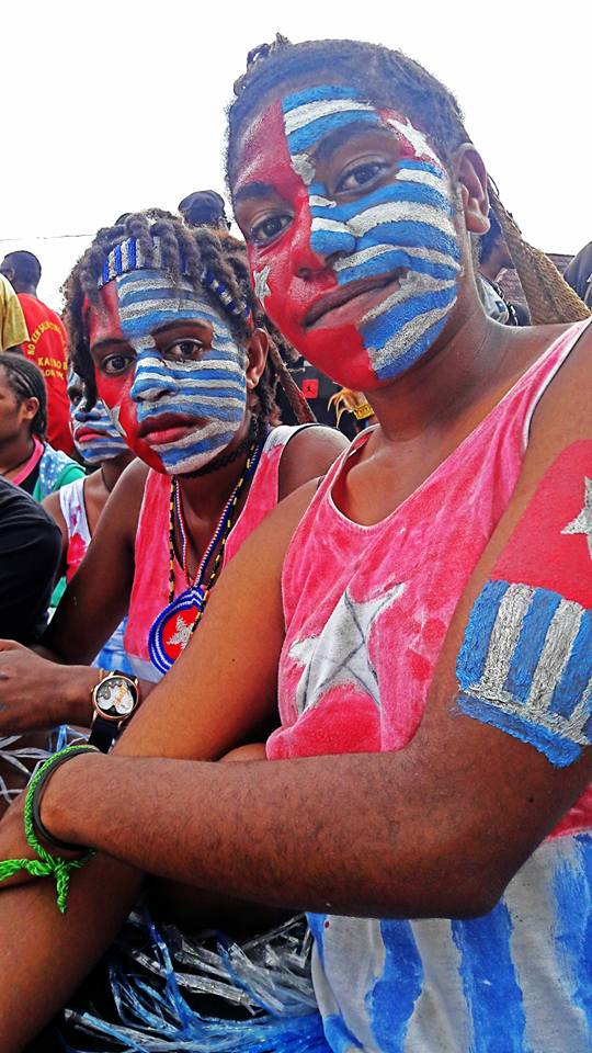 West Papuan youths taking selfies in Port Numbay/Jayapura at a mass rally calling for Wets Papua's full membership of the Melanesian Spearhead Group (MSG). June 2016.