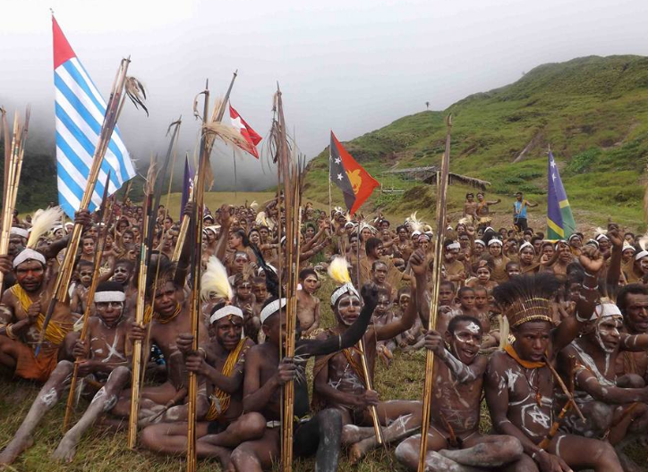 West Papuan people in the Star Mountains region on the border with Papua New Guinea raise Melanesian flags and call to come back to the Melanesian family as a full member of the Melanesian Spearhead Group (MSG).
