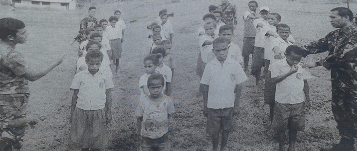 Indonesian military taking the place of teachers and lining West Papuan children up in their Primary School
