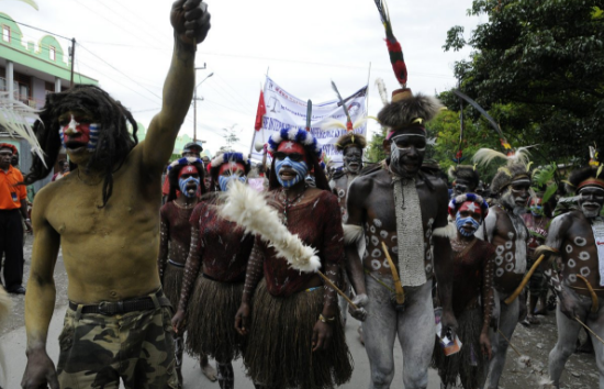Proudly Melanesian not Indonesian. West Papuan people rally in the streets of the Highlands town of Wamena to call for freedom from Indonesian colonialism.