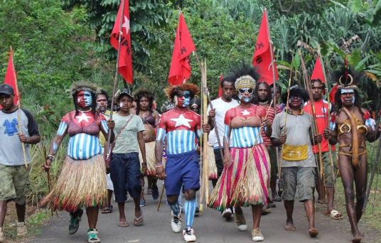 Culture as resistance! West Papuan people proudly displaying their national flag and marching down the streets to peacefully call for self-determination and Independence.