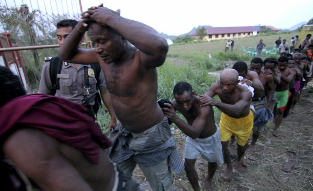Lined up like slaves and stripped of their clothes. culture and dignity. West Papuan people are herded away to be tortured by the Indonesian police after attending a peaceful pro-Independence Congress in 2011